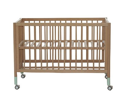 Baby cot with green leg