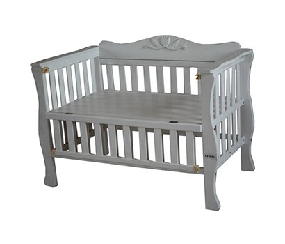 baby cot with carved flower